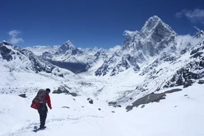 Sherpa Guide Walking over Cho La Pass with Ama Dablam on Left and Arakam Tse on Right Side by Peter Barritt