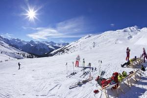 Skiers Relaxing at Cafe in Winter Sunshine, Verdons Sud, La Plagne, French Alps, France, Europe by Peter Barritt