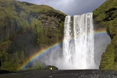 Skogafoss Waterfall with Rainbow in Summer Sunshine, South Coast, Iceland, Polar Regions by Peter Barritt