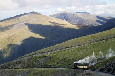 Steam Engine and Passenger Carriage on Trip Down Snowdon Mountain Railway, Gwynedd, Wales