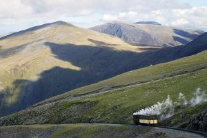 Steam Engine and Passenger Carriage on Trip Down Snowdon Mountain Railway, Gwynedd, Wales by Peter Barritt