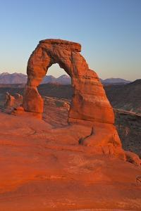 Sunset at Delicate Arch, Arches National Park, Moab, Utah, United States of America, North America by Peter Barritt