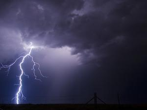 A Cloud to Ground Lightning Strike Severs the Sky by Peter Carsten