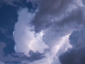 A Lightning Strike Severs the Cloud Filled Sky by Peter Carsten