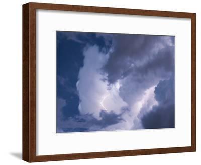 A Lightning Strike Severs the Cloud Filled Sky