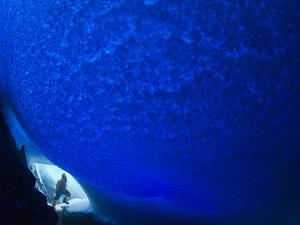 A Microbiologist Underneath the Blue Dome of an Ice Cave by Peter Carsten