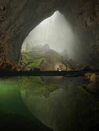 A Rock Formation Shines Beneath a Skylight in Hang Son Doong
