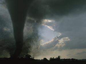 An F3 Category Tornado Swirls Across a South Dakota Prairie by Peter Carsten