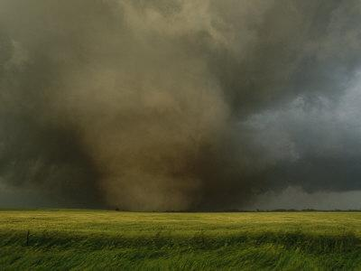 An F4 Category Tornado Travels Across a Field at Great Speed