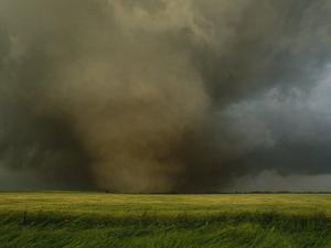 An F4 Category Tornado Travels Across a Field at Great Speed by Peter Carsten