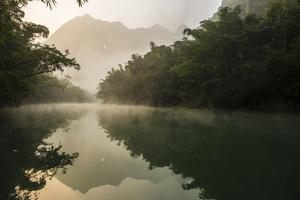 Chuanzhang Cave Looms Above the Getu River by Peter Carsten