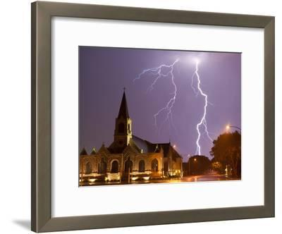 Cloud to Ground Lightning Strikes Sever the Sky Above a Church