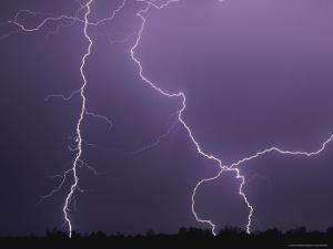 Dramatic Bolts of Lightning Crisscross a Night Sky by Peter Carsten