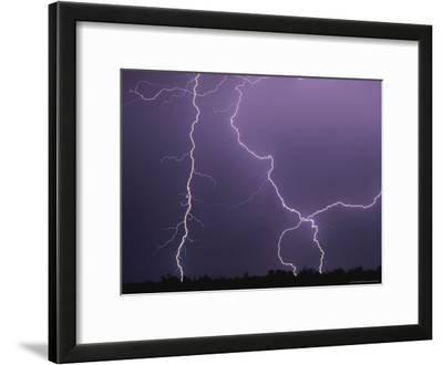Dramatic Bolts of Lightning Crisscross a Night Sky