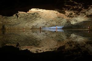 Expedition Members Pause at a Subterranean Lake on the Way to Titan Chamber by Peter Carsten