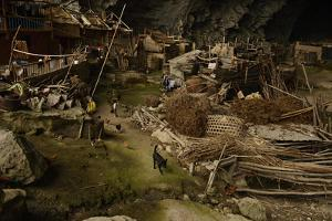 Families from the Miao Minority Live under the Roof of a Cave by Peter Carsten