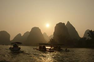 Sightseers on Large Tour Boats or Small Bamboo Rafts Take Daylong Tours on the Li River by Peter Carsten