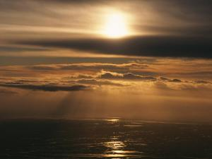 Sunset and Clouds over the Ocean by Peter Carsten
