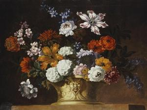 Tulips, Snowballs and Other Flowers in a Sculpted Urn on a Ledge by Peter Casteels