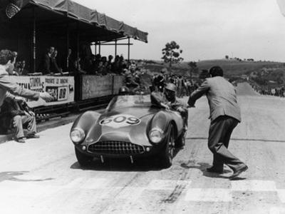 Peter Collins at the Wheel of an Aston Martin
