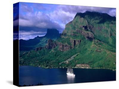 A Sailboat Cruises Past Mountainous Shoreline, Moorea, Society Islands, The, French Polynesia