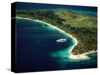 Aerial of Blue Lagoon Cruises Ship Anchored Off Island, Fiji