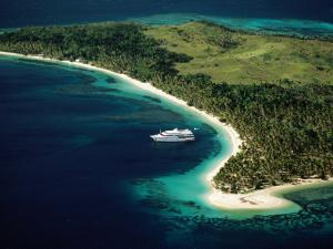Aerial of Blue Lagoon Cruises Ship Anchored Off Island, Fiji by Peter Hendrie