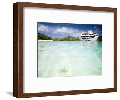 Blue Lagoon Cruises Ship and Starfish in Water, Fiji
