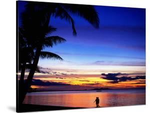 Couple Walking Along Beach at Sunset, Fiji by Peter Hendrie