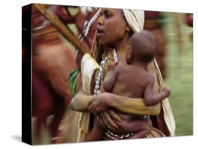 Mother Carrying Baby, Blur, Papua New Guinea