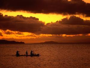 Sunset Over the Sea with an Outrigger in Silhouette, Upolu, Samoa, Upolu by Peter Hendrie