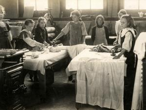 Young Girls Ironing in Laundry Room, Surrey by Peter Higginbotham