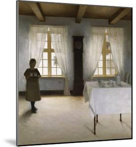 Interior with a Young Girl Serving Tea, 1901 by Peter Ilsted