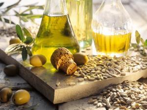 Various Oils in Carafes, Olives, Sunflower Seeds by Peter Rees