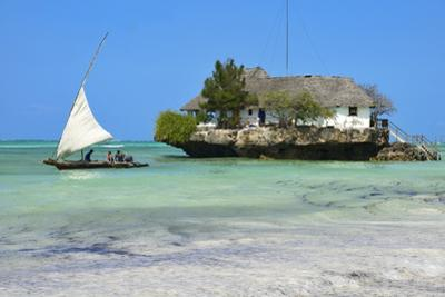 Tourist on a Traditional Dhow Boat, the Rock Restaurant, Bwejuu Beach, Zanzibar, Tanzania