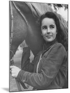 13-Yr-Old Actress Elizabeth Taylor with Her Favorite Pet, a Horse Named Peanuts by Peter Stackpole