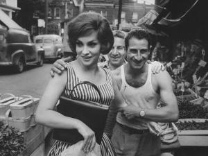 Actress Gina Lollobrigida Talking with Vegetable Vendors by Peter Stackpole