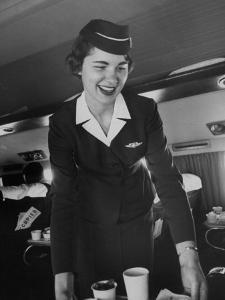 Airline Stewardess Seving Coffee by Peter Stackpole