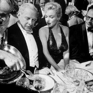 Ambassador Winthrop Aldrich, Ex Envoy to Britain Chatting with Actress Marilyn Monroe by Peter Stackpole