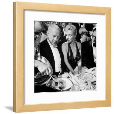 Ambassador Winthrop Aldrich, Ex Envoy to Britain Chatting with Actress Marilyn Monroe
