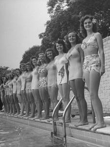 California and Florida Bathing Beauties Participating in a Contest by Peter Stackpole