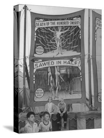 Children Sitting in Front of Banners for Magic Show Being Performed by Orson Welles