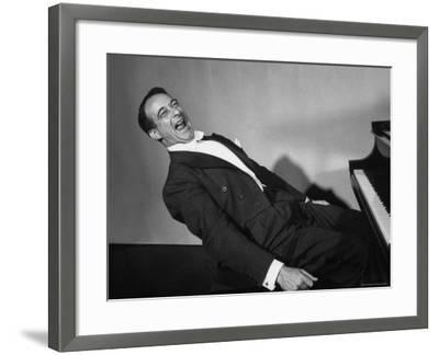 Comedian Pianist Victor Borge, in White Tie and Tails, Sitting at Piano and Making Funny Faces