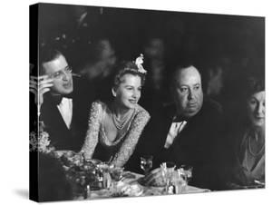David O. Selznick,Joan Fontaine, and Alfred Hitchcock and Wife at Academy Award Presentation Dinner by Peter Stackpole