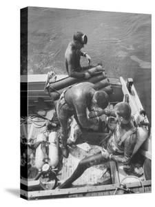 Divers Preparing to Dive to the Sunken Liner Andrea Doria by Peter Stackpole