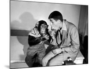 Entertainer Jerry Lewis with a Chimpanzee by Peter Stackpole