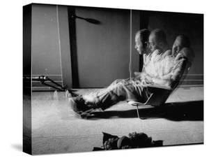 Film Director Billy Wilder Sitting in Chair Designed by Charles Eames Made of Plastic by Peter Stackpole