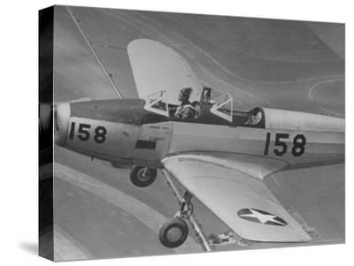 Fledgling Pilot of the Women's Flying Training Detachment Soloing in Her Pt 19 Army Trainer