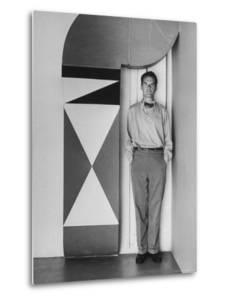 Full Length Portrait of Designer Charles Eames at Home by Peter Stackpole