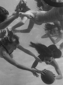 Girl Getting Her Hair Pulled as Swimmers Play a Fast Scrimmage of Water Polo at Athletic Club by Peter Stackpole